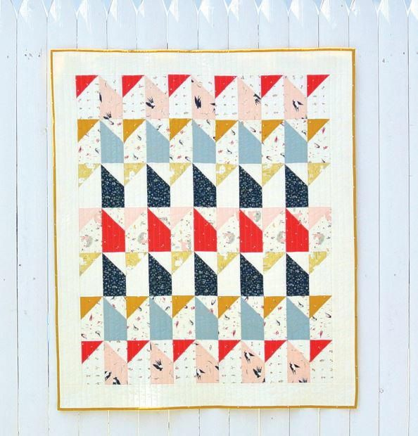 Little Houses Baby Quilt Pattern | Do you have a new grandbaby on the way? Be sure to download this modern baby quilt pattern for free!