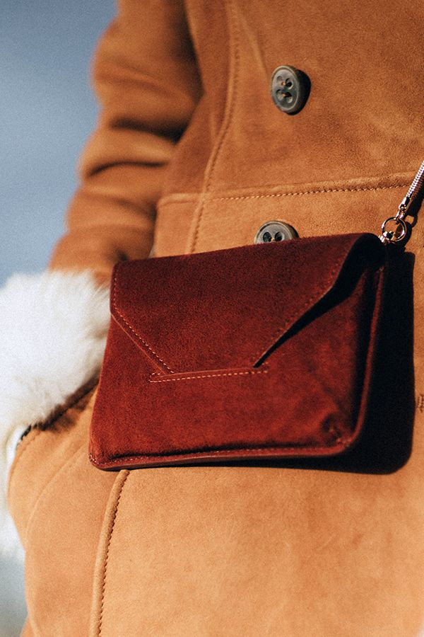 Cut from the softest suede and in a rich tobacco tone, Filippa K's envelope-style shoulder bag has an air of Seventies cool. With a versatile gold-trimmed shoulder strap, carry for an easy way to colour block contrasting coloured knits.