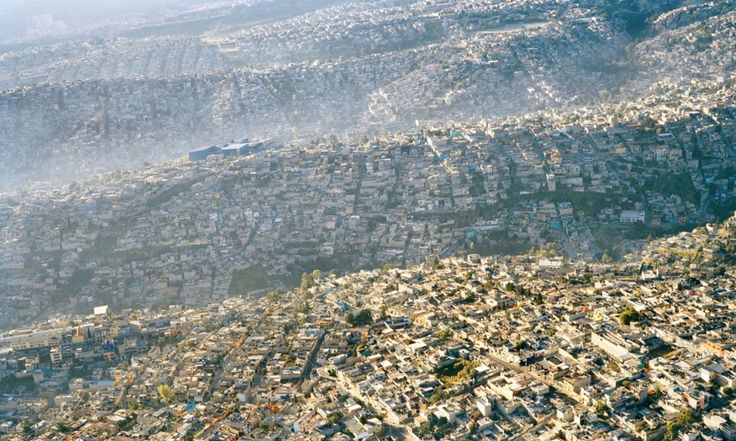 Waves of humanity Sprawling Mexico City rolls across the landscape, displacing every scrap of natural habitat   Photograph: Pablo Lopez Luz
