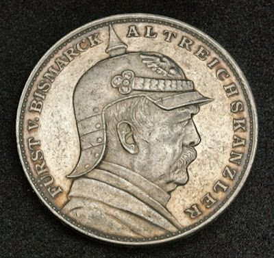 Coins of Germany Prussia, Otto von Bismarck wearing military spiked helmet Pickelhaube, Silver Mourning Thaler Coin of 1898. Obverse: Bust of Otto von Bismarck wearing a cuirassier officer's metal Pickelhaube
