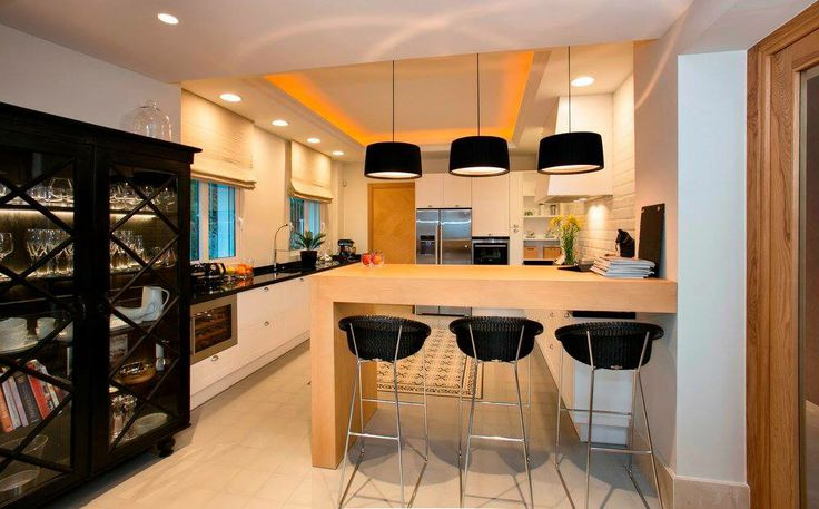 Kitchen @casabond Interior by Cote Sud and Rodolfo Jacobson. Mixture of old soliter armoar and modern Vincent & Sheppard stools and Contardi pendants.