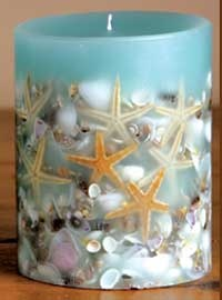 "Beach House  Our favorite candle is back and even bigger. This nautical themed candle is filled with real shells and starfish. Smells of sand, sun and water. 5"" diameter x 6.5"" tall. 200 hour burn time"