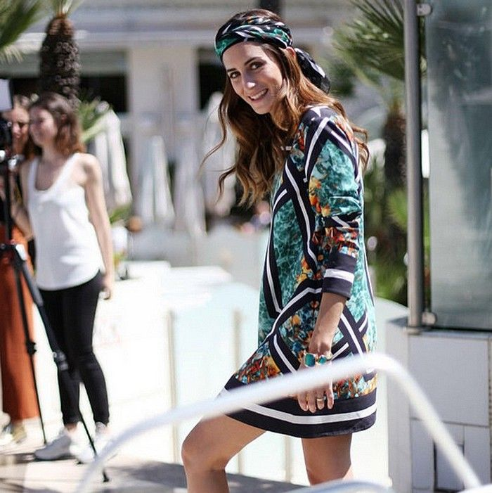 Gala Gonzalez in a mixed print dress and matching headscarf