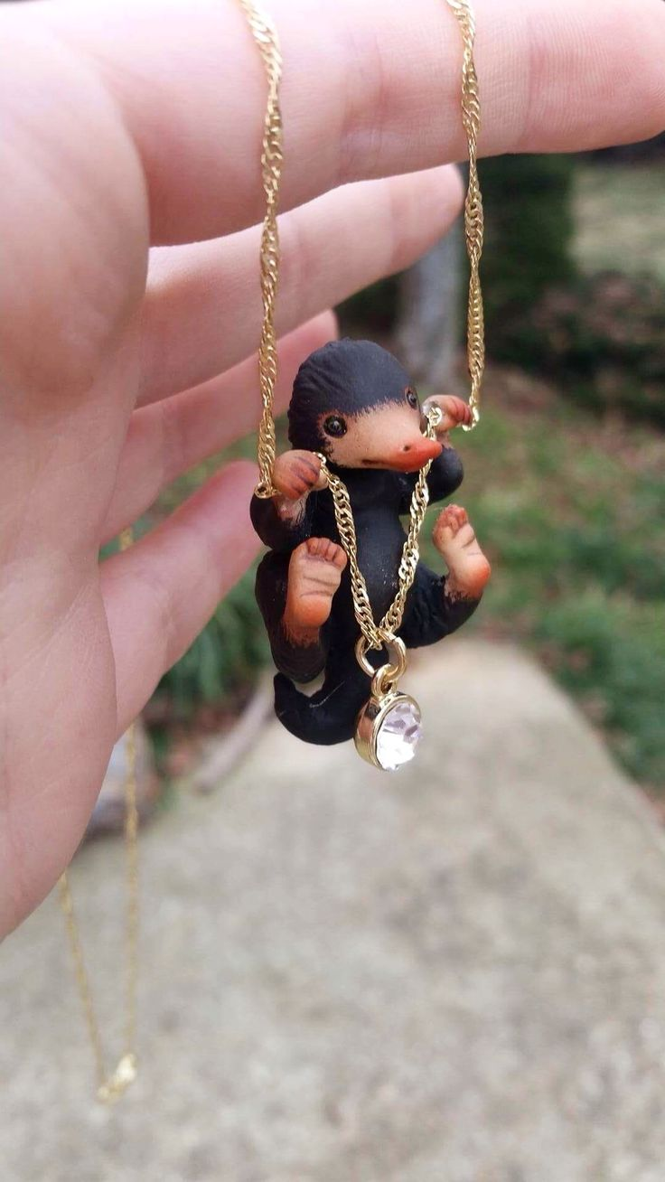 omg omg omg omg omg AMAZING Harry Potter / Fantastic Beasts and Where to Find Them Niffler Necklace by Aisha Voya {aishavoya.com}