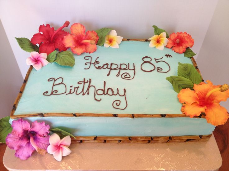 Hawaiian birthday cake - This cake is blue butter cream, fondant bamboo, with sugar flowers