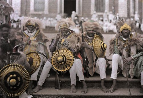 Autochrome: W. Robert Moore. Ethiopia's veterans, in traditional costumes, sit on Cathedral steps. Ethiopia, Africa.