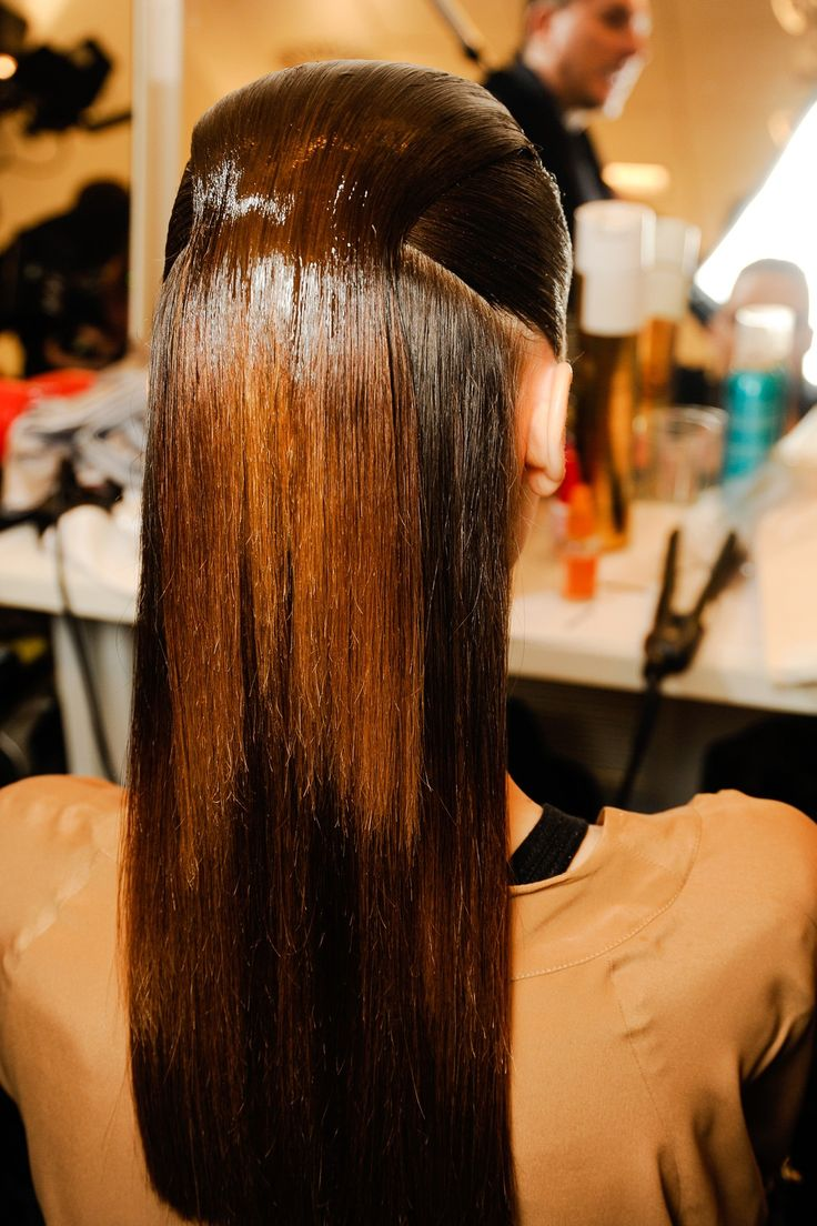Backstage Hair: Autumn/Winter 2013-14 - Gucci: The front section of the hair was then swept back and painted with gel for a sleek, wet-look finish.
