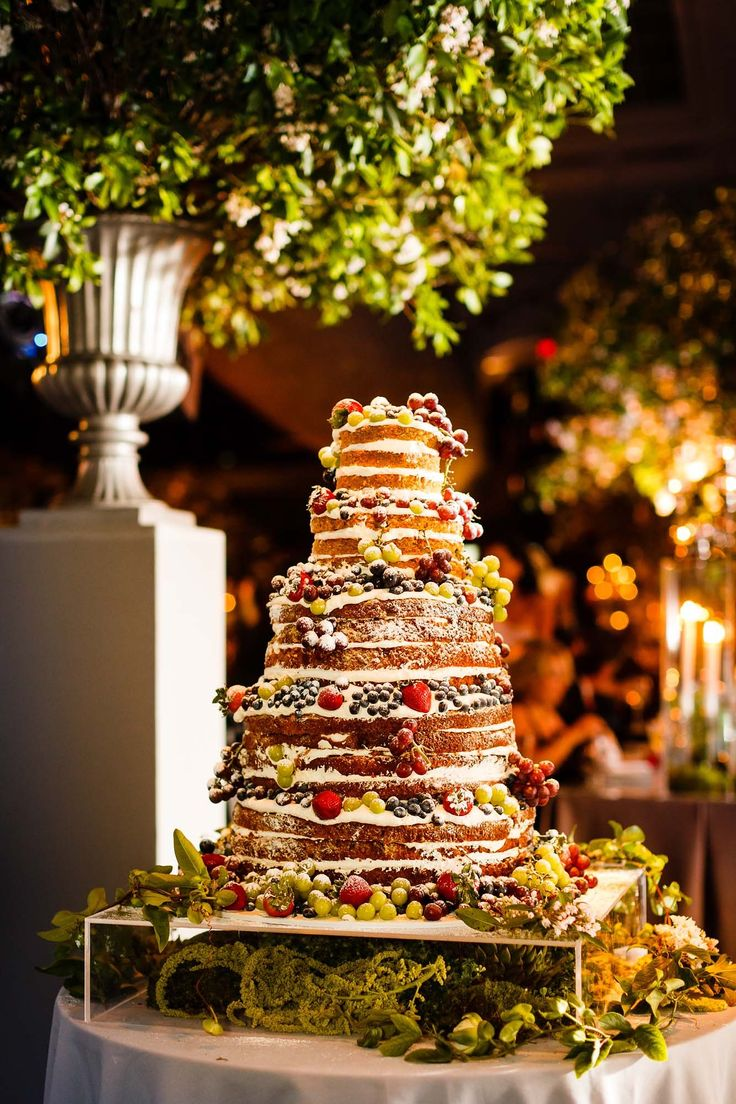Michael knows cake is extremely important to me, so he told me to dream up the most incredible wedding cake imaginable and just go for it. We went with a carrot cake with layers of buttercream and all sorts of berries bursting out of it.