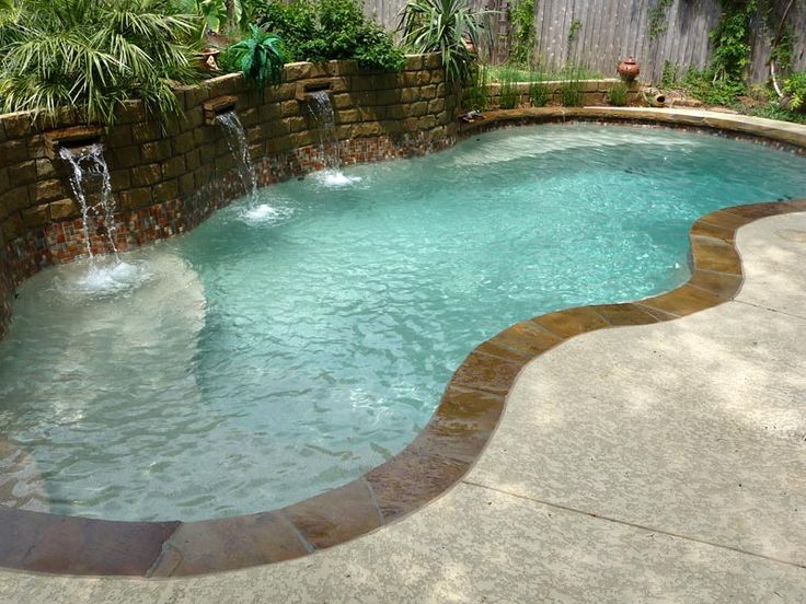 Viking pools love the retaining wall with the small water for Pool design retaining wall