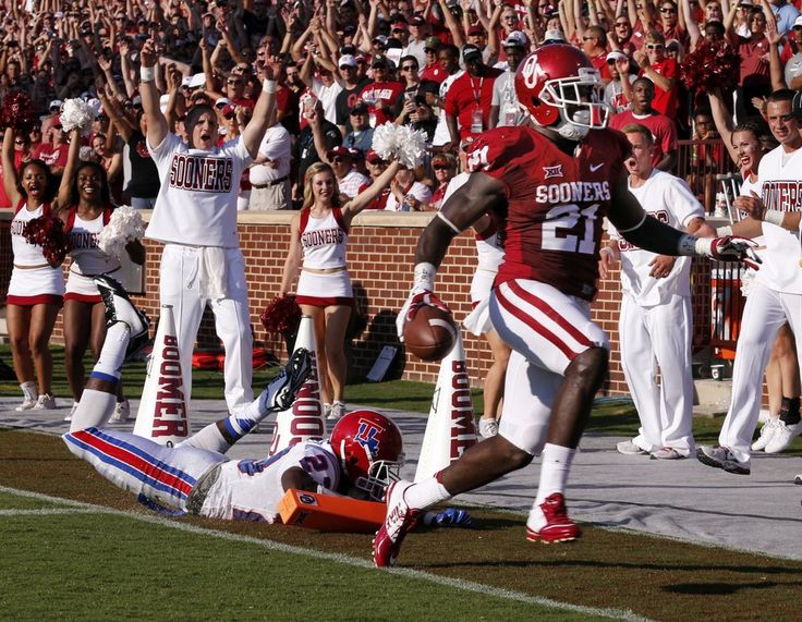 Oklahoma Sooners's Keith Ford (21) scores the first touchdown of the game during a college football game between the University of Oklahoma Sooners (OU) and the Louisiana Tech Bulldogs at Gaylord Family-Oklahoma Memorial Stadium in Norman, Okla., on Saturday, Aug. 30, 2014. Photo by Steve Sisney, The Oklahoman