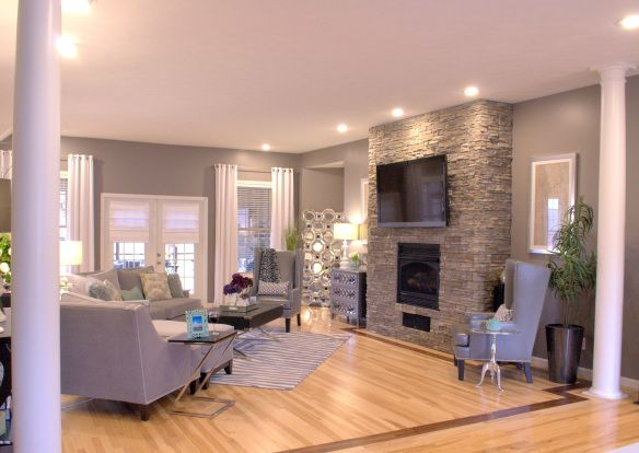 Grey + white great room makeover with ZGallerie. Stacked stone fireplace