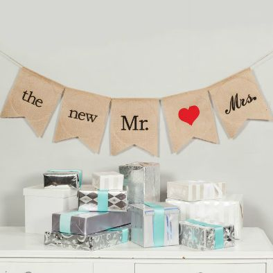 """Decorate your bridal shower, your gift table, guest book table or cake table with this five piece burlap pennant banner with wording """"The New Mr."""