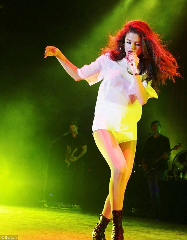 Dance number: The mega superstar princess singer Selena Gomez stepped through her number in a pair of stiletto boots