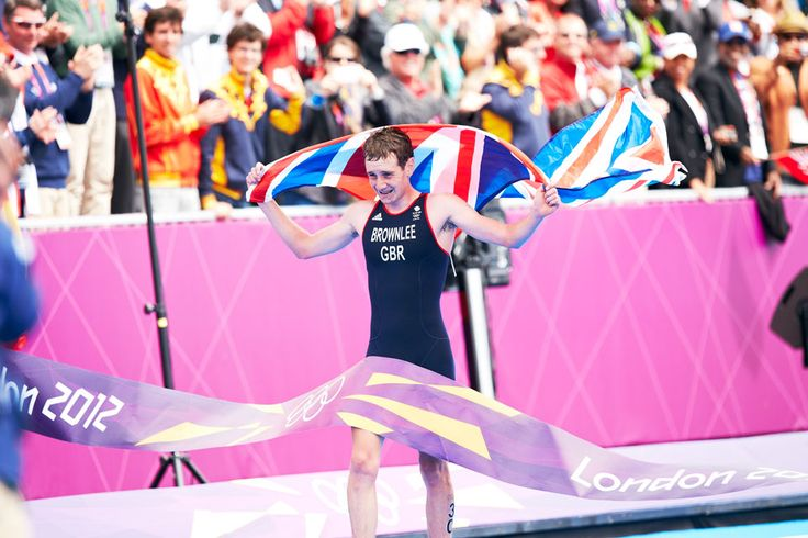 London 2012 - Alistair Brownlee of Great Britain takes the tape for gold in men's triathlon.  IOC/John Huet