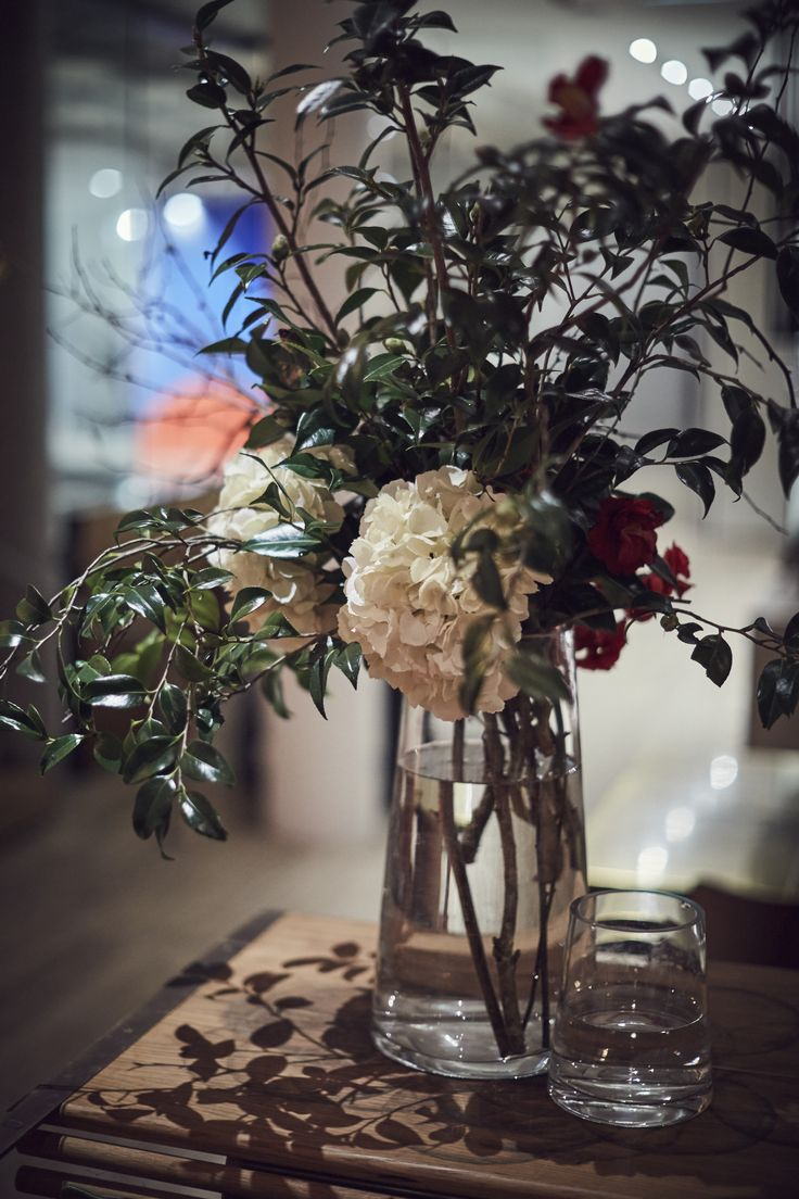 Camellia trees in bloom are one of the best things about Sydney in Winter, so it's fun to pop them in arrangements as a reference for the season when you're looking back at photos.   Click image to see more of this wedding on the blog.   Floreat   Sydney Wedding   Wedding Flowers   Vase Arrangement