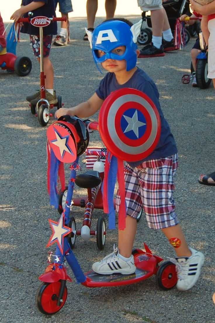 4th of july bike parade. Captain America at the boys neighborhood bike parade.