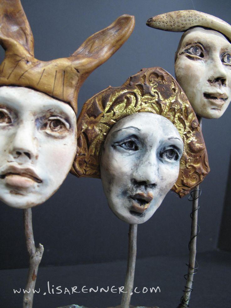Polymer clay masks on sticks by Lisa Renner.