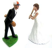 Custom baseball pitching groom wedding cake topper sculpted to look like the bride and groom!