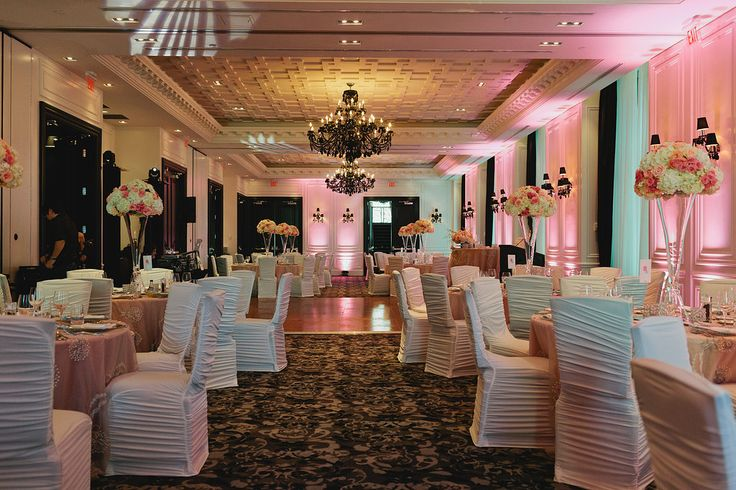 Reception at Trump Hotel - Beautiful Decor...white chair covers, pink and white colour scheme, tall vases with hydrangeas, pink and blush roses centre pieces http://www.fusion-events.ca/