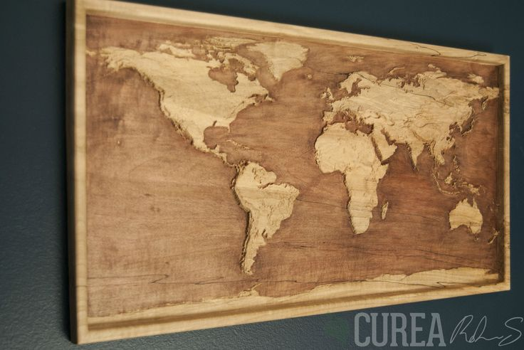 Wood relief carving by curea map world