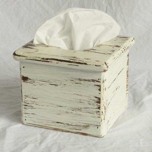 This wooden tissue box holder suits boutique facial tissue boxes like Kleenex or Sorbent. The holder has a circular opening at the top and an open bottom.
