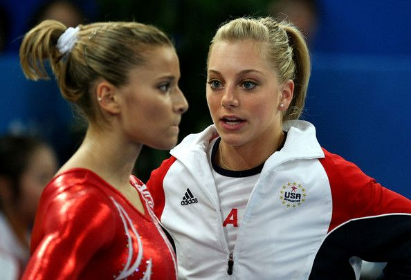 Samantha Peszek Photos Photos - (L-R) Alicia Sacramone of the United States reacts as she stands next to teammate Samantha Peszek during the artistic gymnastics team event at the National Indoor Stadium during Day 5 of the Beijing 2008 Olympic Games on August 13, 2008 in Beijing, China. - Olympics Day 5 - Artistic Gymnastics