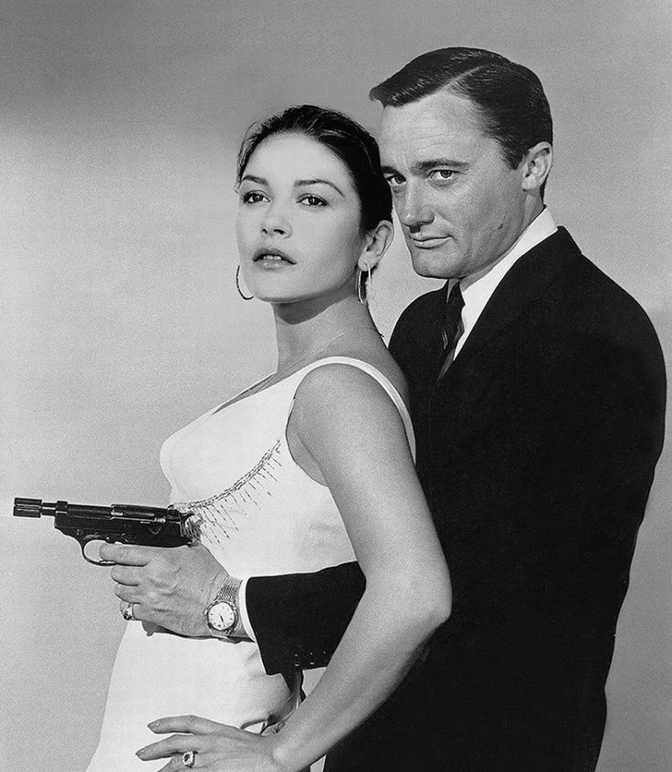 "Catherine Zeta-Jones and Robert Vaughn in The Man from U.N.C.L.E. episode, ""Madame Zoolander""."