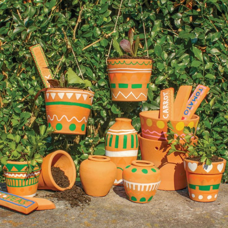 Terracotta is really easy to decorate and looks great. Just use Terracotta and porcelain markers to design your own herb pots!