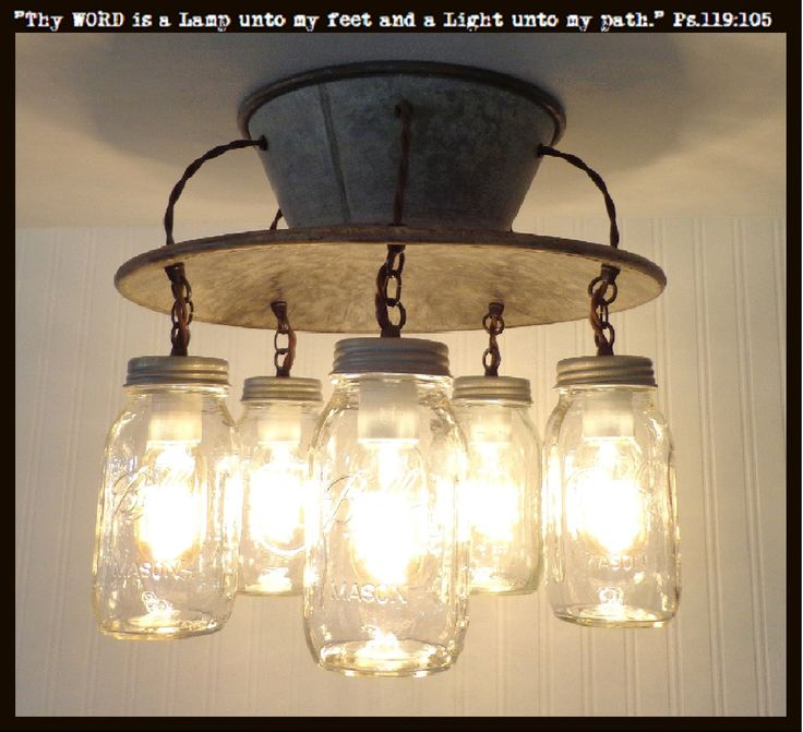 A large, unique mason jar ceiling light features a vintage inspired metal round mounting plate & five mason jars with a look of days gone by. The authenticity of each mason jar pendant shows its trade