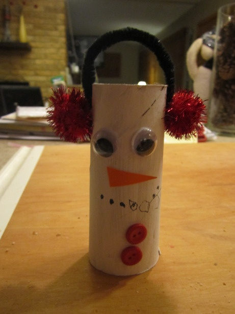 Snowman craft out of toilet paper roll.