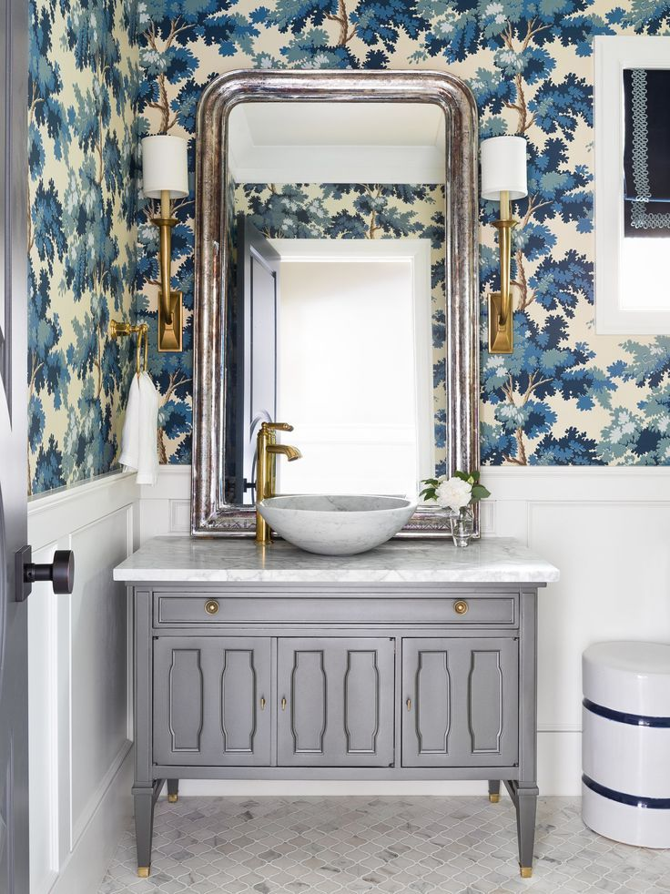 Pretty Guest Bathroom With Grey Vanity Wainscot Paneling And Blue Wallpaper Powder Room Design Bathroom Design Bathroom Wallpaper