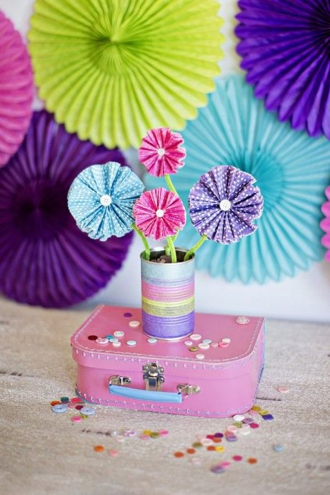 Flowers made out of cupcake papers - crafts meant for kids but I would love to do this!