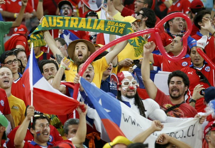 Fans cheer ahead of the 2014 World Cup Group B soccer match between Chile and Australia at the Pantanal arena in Cuiaba June 13, 2014.