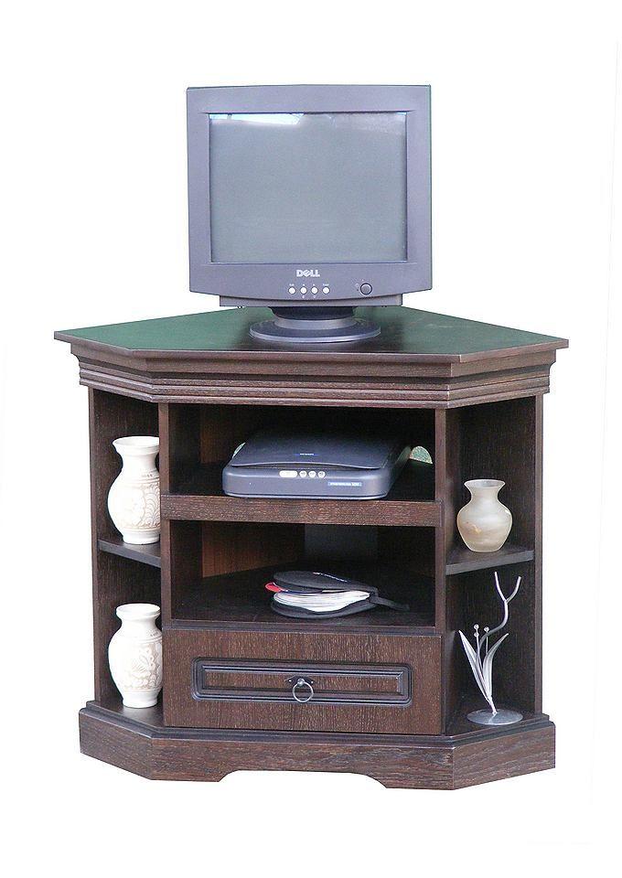 TV Eckkommode. Qualität aus Eiche. Die Fronten sind Eiche teilmassiv, der Kopus Echt Eiche furniert. Metallgriffe und -scharniere garantieren eine lange Haltbarkeit. Im warmen Tabak-Ton gebeizt oder in Alt-Weiss lackiert lieferbar. Möbel werden aufgebaut angeliefert. TV-Eckkommode, in der Mitte 2 offene Gerätefächer, darunter 1 Schubkasten, außen jeweils 2 offene Fächer Ca.-Maße: (B/T/H): 87/54...