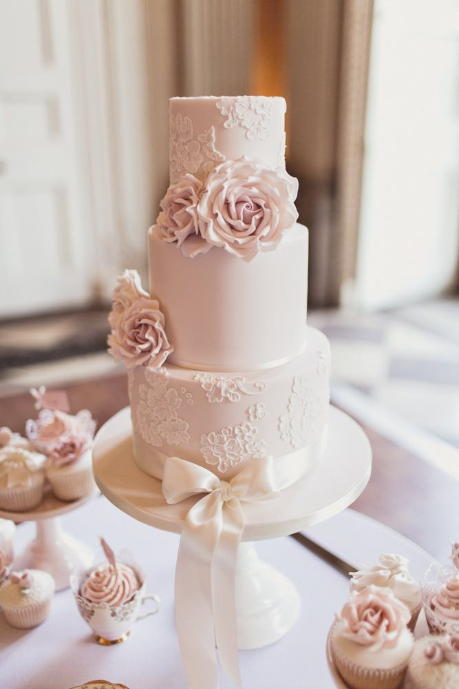 Elegant Three Tier Dusky Pink Lace Wedding Cake by Cotton and Crumb | Classic wedding at Ragley Hall | Pink Colour Scheme | Pastel Flowers | Image by Anna Clarke Photography |  http://www.rockmywedding.co.uk/naomi-mark/ #pinkweddingcakes