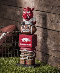 Everyone will want to add this decorative tiki totem to their garden or gameday decor! Inspired by the original Hawaiian style tiki totems, this polystone handpainted sports themed totem shows your te