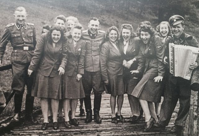 Taking a break from mass murder and sadism. Personnel from Auschwitz extermination camp having a day off.