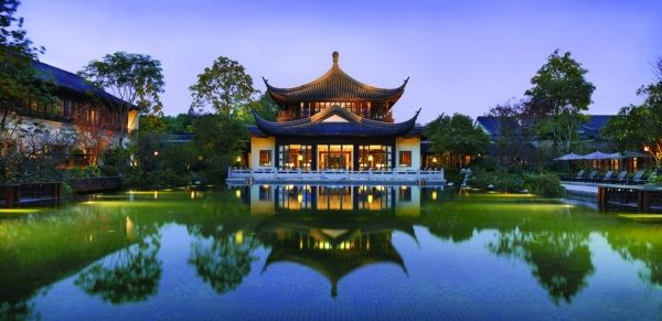 """The Hangzhou hotel consists of a series of pagoda-shaped buildings, including this pavilion housing its lobby and lobby lounge. Photo: Ken Seet<br /><br /><a href=""""/content/four-seasons-denver-and-hangzhou-china"""" class=""""active"""">View Image Details</a>"""