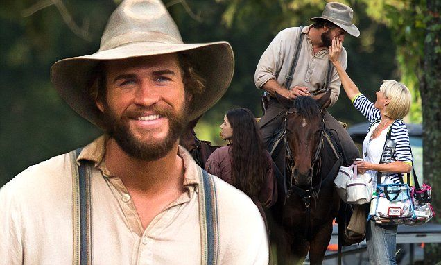 Liam Hemsworth sports new bushy beard while filming By Way of Helena