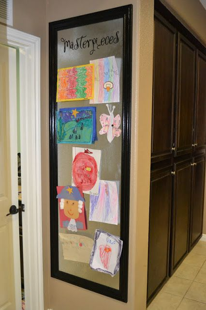Kid's Artwork Display Board. I think this would be great in the kitchen wall  somewhere