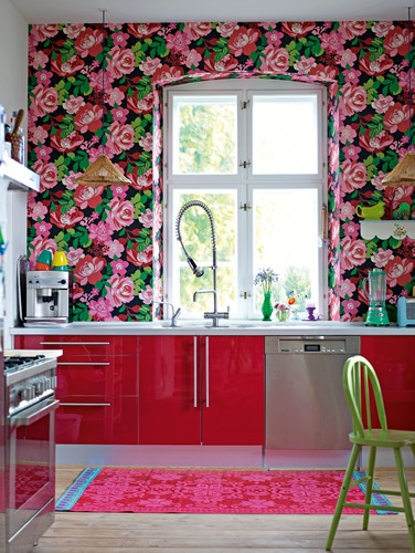 Bold pink floral wallpaper, bright accents, hot pink cabinets