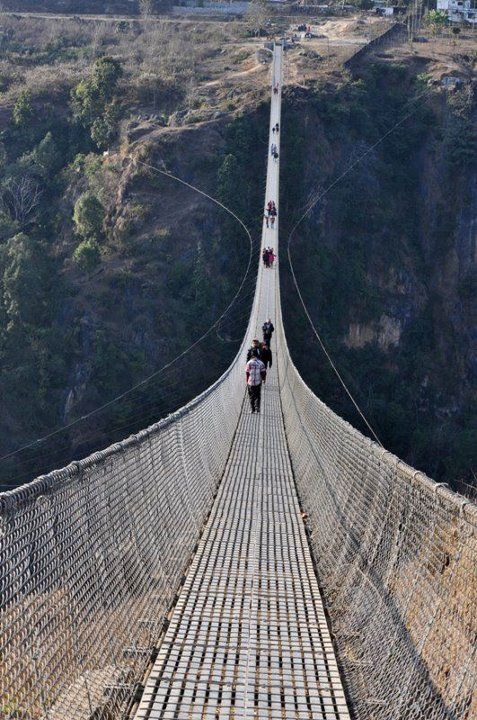 Topmost and largest Suspension Bridge In Nepal. Villagers in Parbat district of…