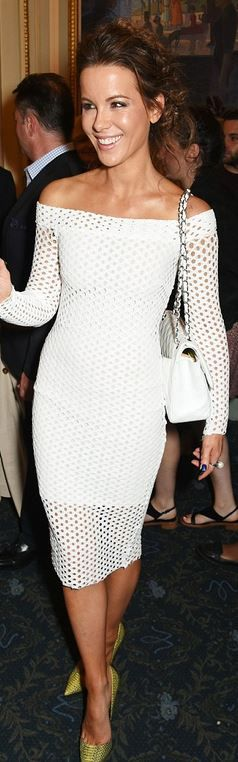 Who made  Kate Beckinsale's mesh off the shoulder dress, green pumps, and white handbag?
