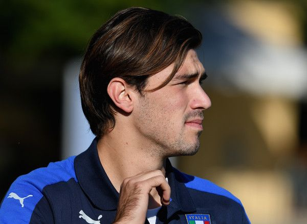 Alessio Romagnoli  of Italy looks on prior to the training session at the club's training ground at Coverciano on October 4, 2016 in Florence, Italy.