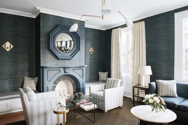 Luxurious Blue And White Living Room Is Illuminated By An Aerin Sommerard Medium Triple Arm