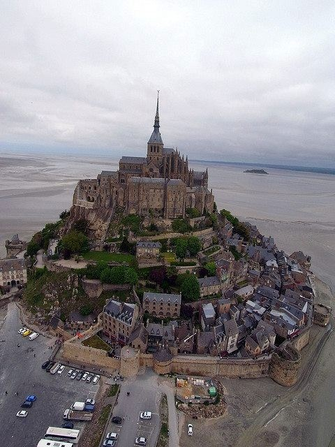 Mont Saint Michel, Normadie, France. I love how the streets just wrap up around the hill. As soon as you step foot in this place you feel transported back in time. I would love to live here for a while!