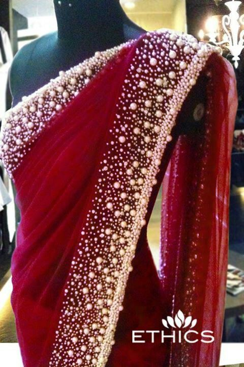 maroon Red saree with a pearl border: