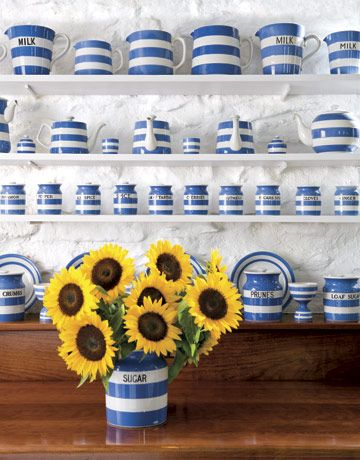 Pottery Collection,Make a pottery collection the colorful focal point of a kitchen by showcasing it on open shelves. The expansive assortment of blue-and-white striped pottery sets the tone for this kitchen.    Read more: Kitchen Color - Paint and Color Ideas for Kitchens - Country Living