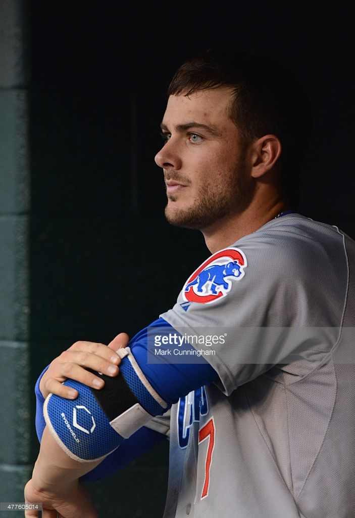 Kris Bryant #17 of the Chicago Cubs looks on from the dugout during the game against the Detroit Tigers at Comerica Park on June 9, 2015 in Detroit, Michigan. The Tigers defeated the Cubs 6-0.