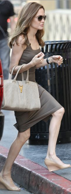 Who made Angelina Jolie's tan tote handbag, brown dress, and nude patent wedges that she wore in Hollywood on April 1, 2012? Purse – Yves Saint Laurent  Dress – Michael Kors  Shoes – Jimmy Choo